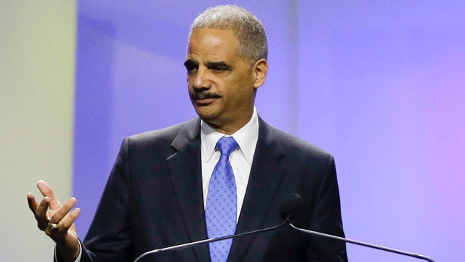 Holder blasts 'Stand Your Ground' laws at NAACP event