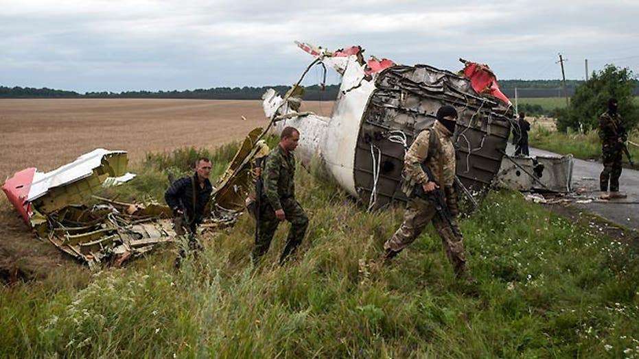 World demands answers after Malaysian jet crashes in Ukraine