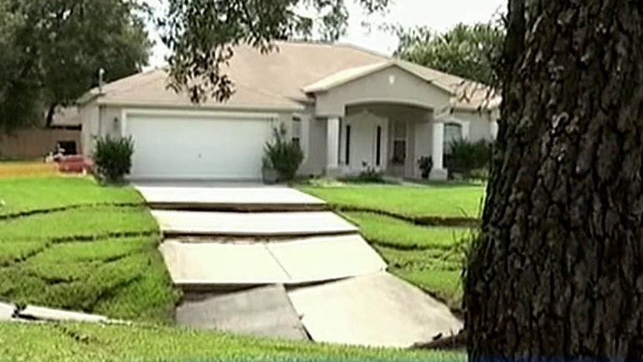 Growing sinkhole continues to swallow homes