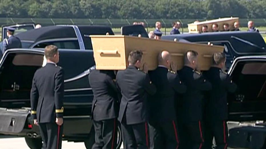 Remains of Flight MH17 victims arrive in the Netherlands