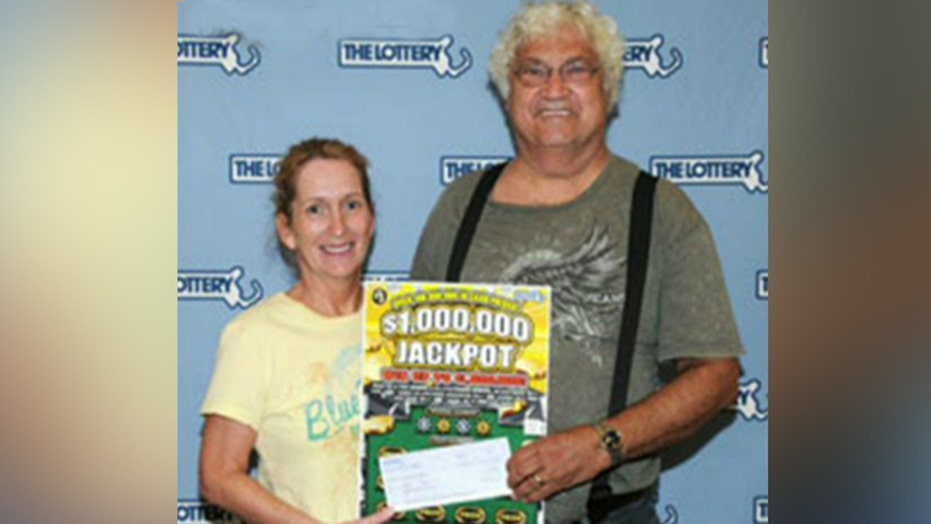 Couple recovers $1 million lotto ticket from trash