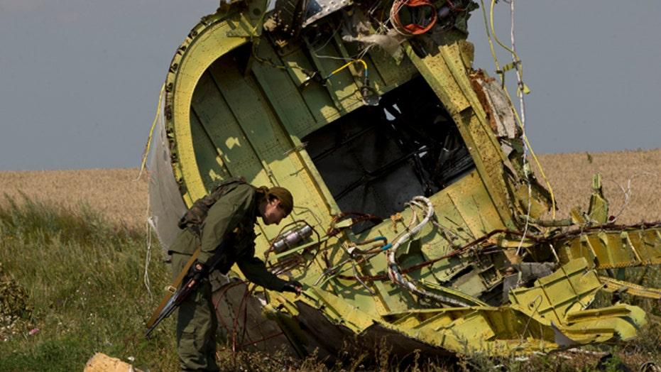 Dutch, Australian experts gain access to MH17 crash site