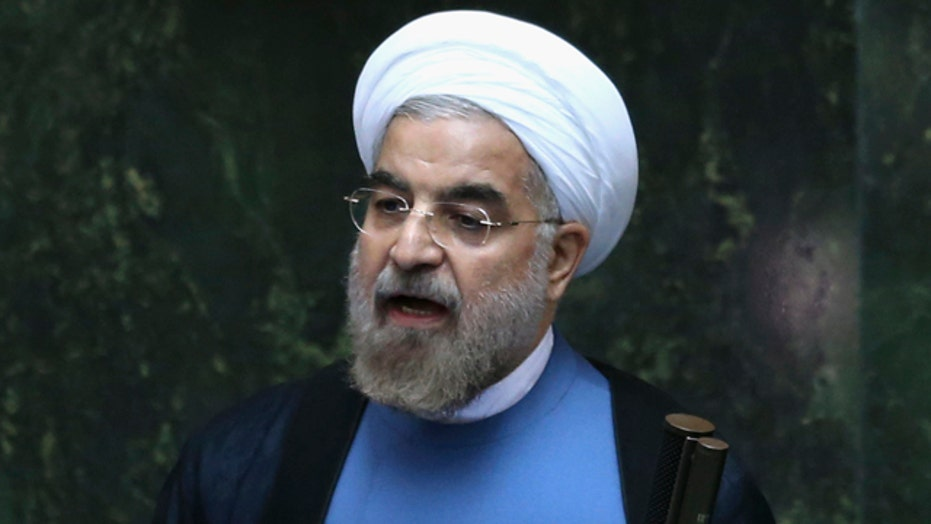 Iran swears in former top nuclear negotiator as president