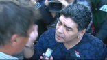 Raw video: Argentinian soccer legend hits journalist