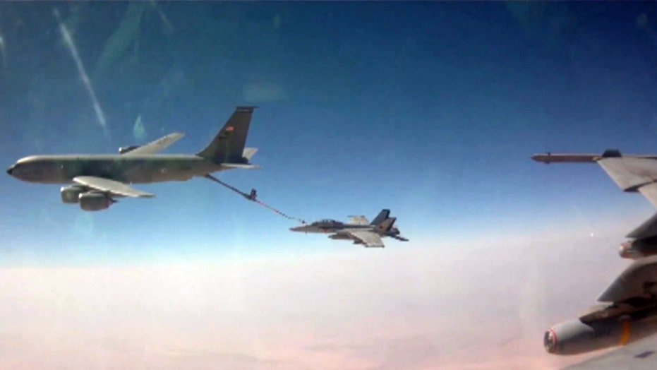 Navy strike fighters perform mission over Iraq