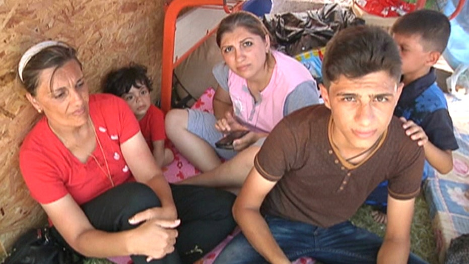 Irbil Christians and other minorities flee ISIS militants
