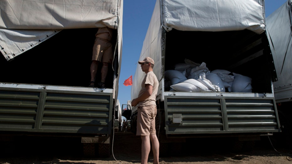 Red Cross inspects Russian aid convoy en route to Ukraine