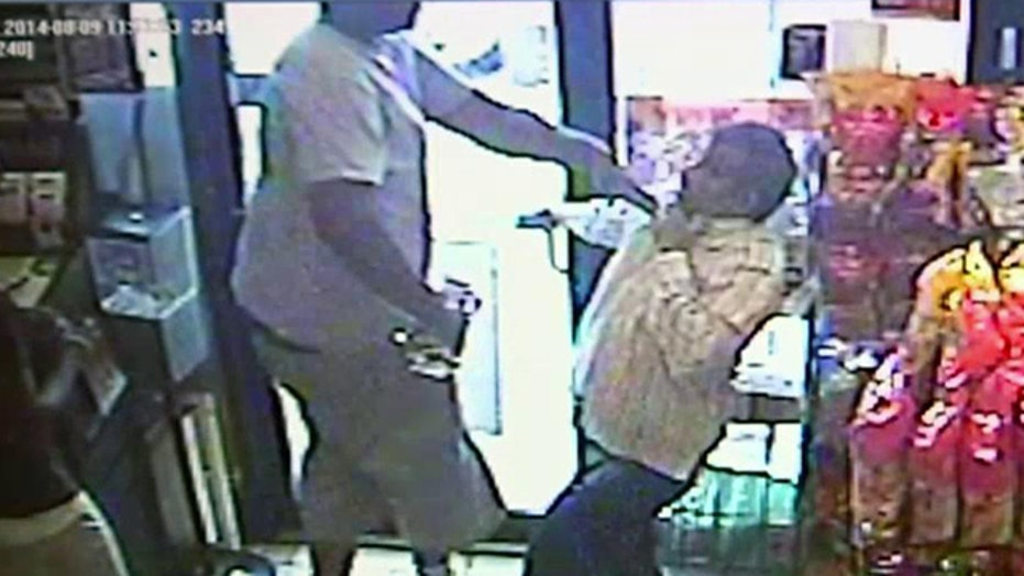 Police release surveillance video of strong-arm robbery