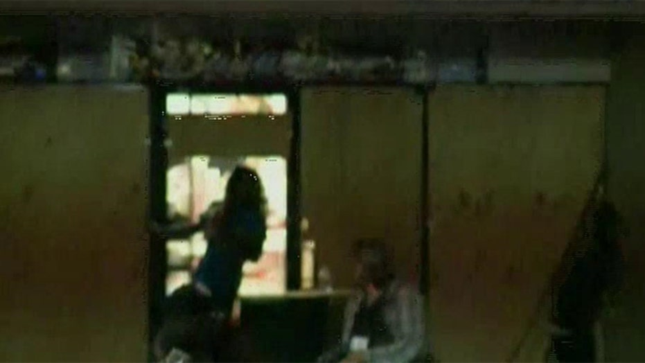 Protesters loot store allegedly robbed by shooting victim