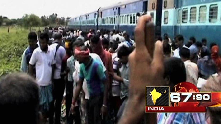 Train crash triggers violent protest in India