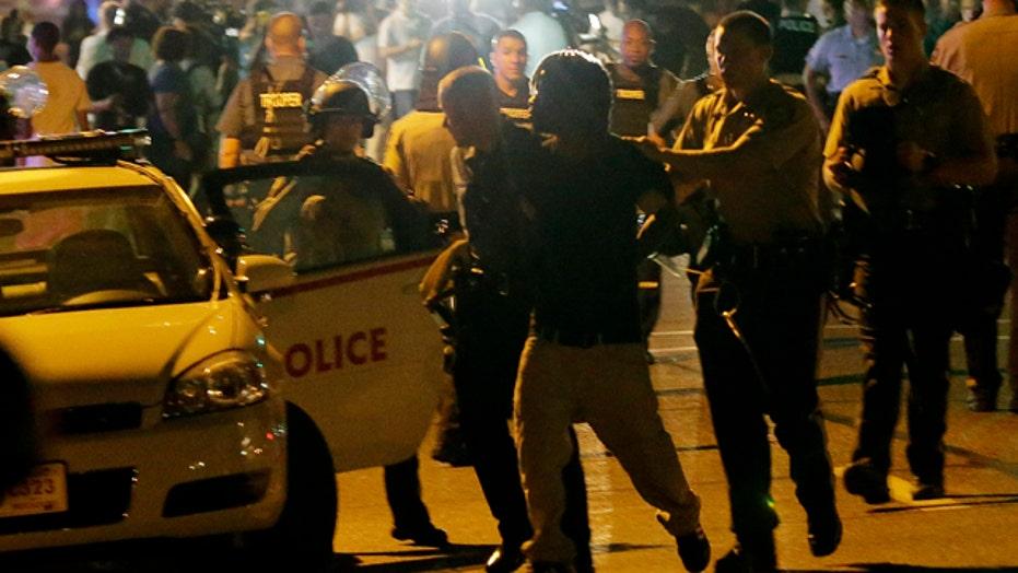 31 arrested, 2 shot as protests turn violent in Ferguson