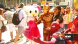 Times Square's costumed characters fight back against negative publicity. At a press conference, they emphasize their right to collect tips and claim they are organizing themselves to address any aggressive behaviour by some.