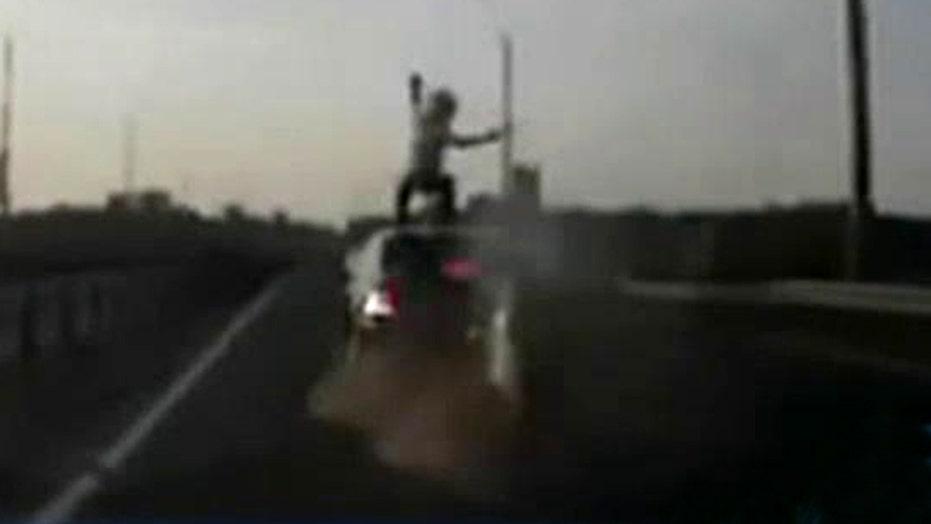 Real or fake? Biker flips onto car after crash
