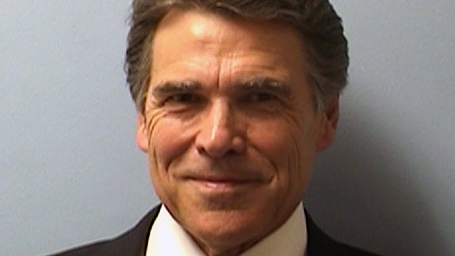 Perry booked on abuse of power charges, vows to 'prevail'
