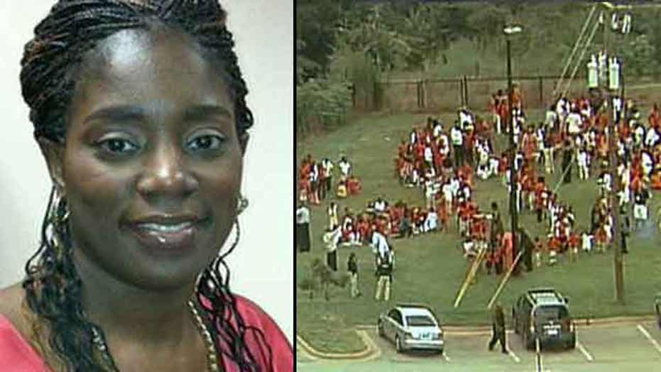 School bookkeeper gets gunman to stand down during 911 call
