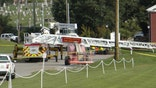 Fire truck's ladder gets too close to power line