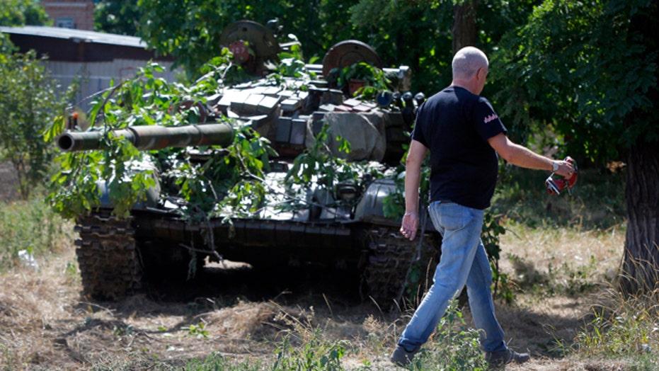 Russia denies launching invasion of Ukraine