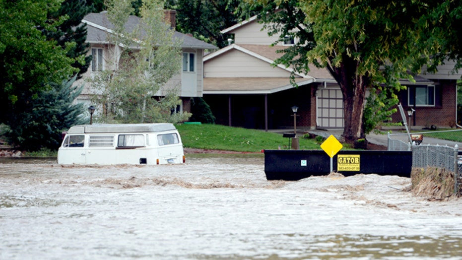 Historic, deadly Colorado floods force thousands to evacuate
