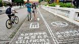 Adjacent lane prohibits phone use