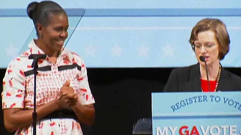 Michelle Obama hits campaign trail for endangered Dems
