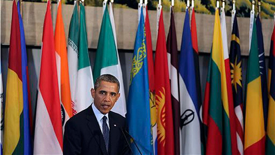 President Obama reaches out to new Iranian president