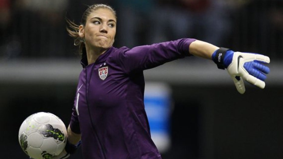 Hope Solo still playing despite domestic abuse charges