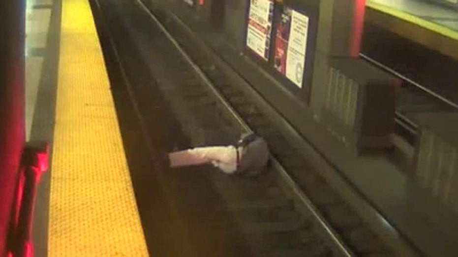 Scary situation: Man falls onto train tracks in Boston