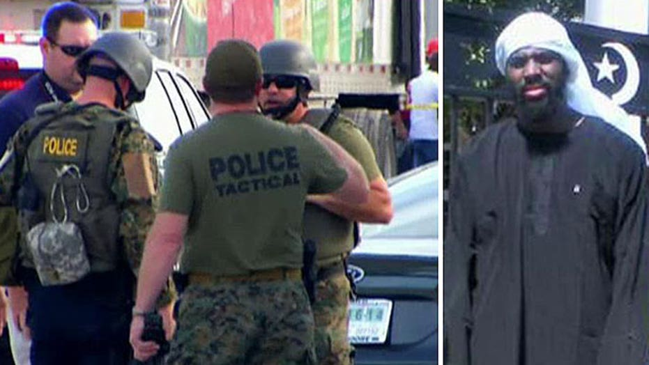 Does workplace beheading suspect have terror ties?