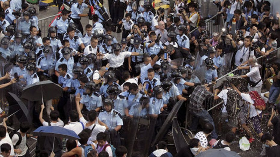 Police clash with democracy demonstrators in Hong Kong