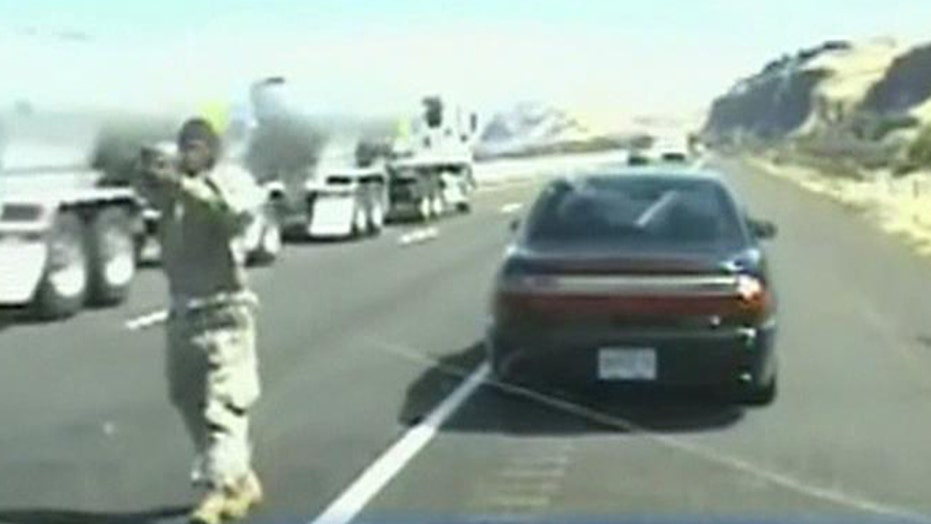 Scary shootout: Driver opens fire on officer