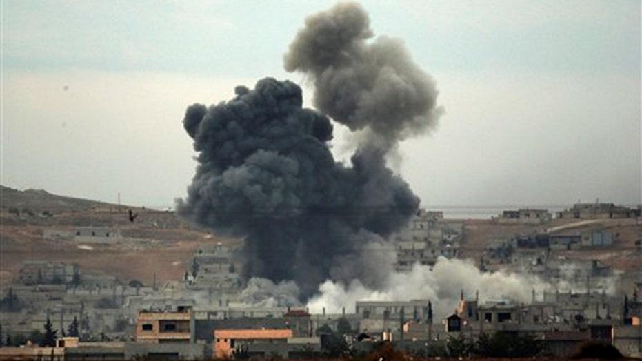 Kurdish fighters battle to reclaim Kobani from ISIS
