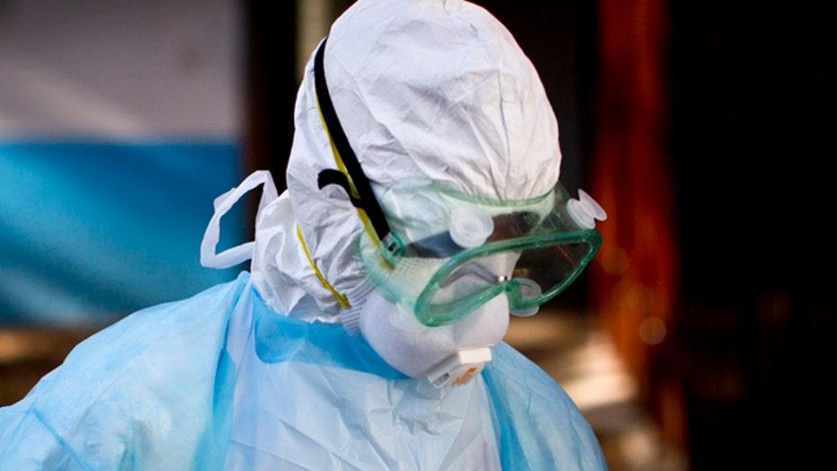 Calls for quarantine before travelers exit West Africa