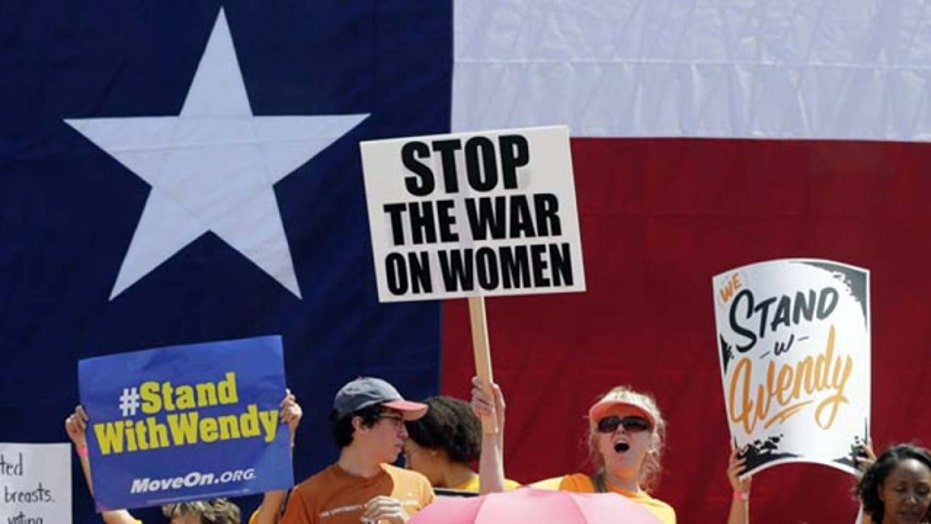 Judge blocks two parts of controversial Texas abortion law