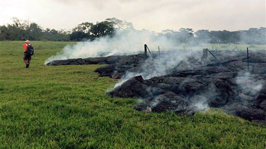 Lava flowing dangerously close to homes in Hawaii community