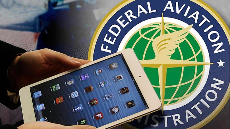 FAA eases gadget restrictions on planes