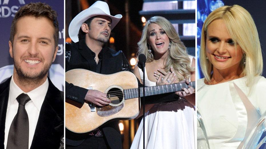 Country stars take aim at Obama; Lambert, Bryan win big