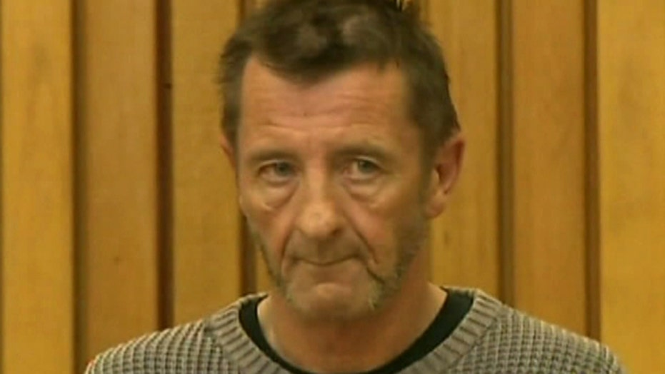 AC/DC Drummer charged in double murder plot