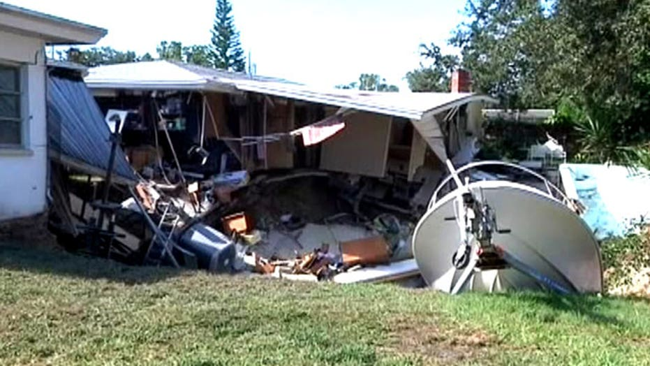 Sink hole swallows parts of 2 homes