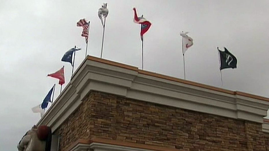 Georgia restaurant owner cited for flying flags
