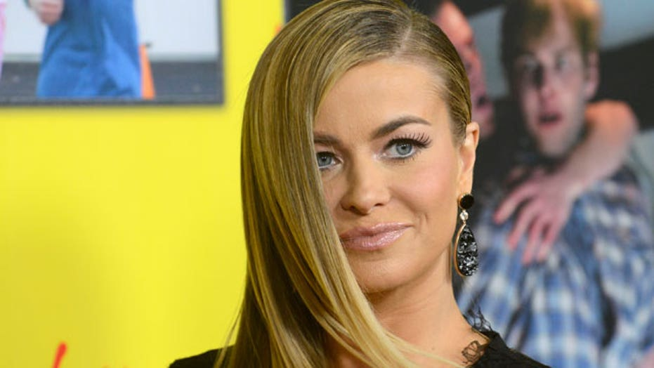 Carmen Electra works out with paparazzi in tow