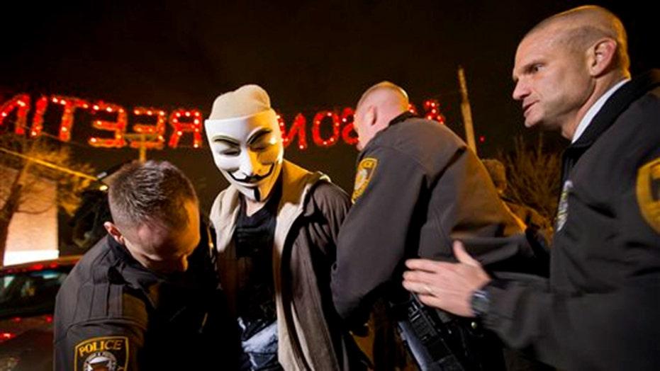 Ferguson awaits grand jury decision in police shooting case