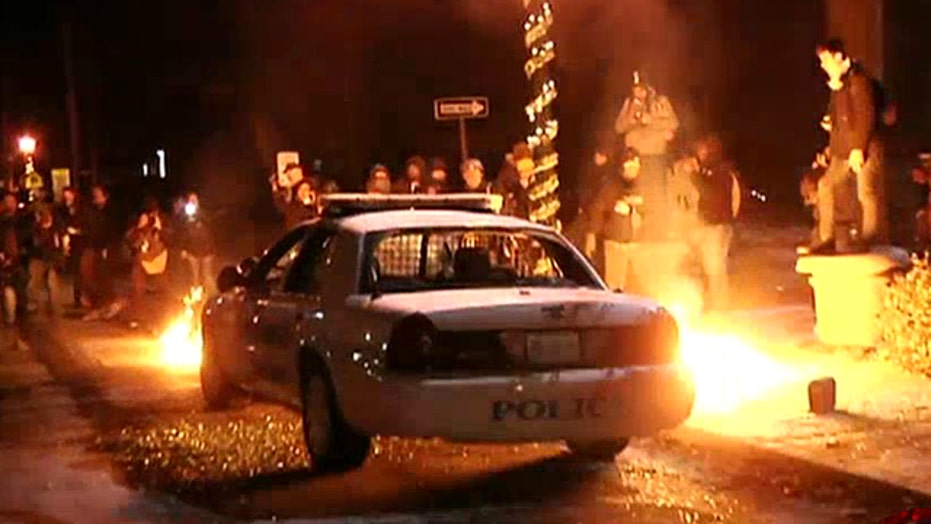 Rioters torch cop car; 44 arrested overnight in Ferguson
