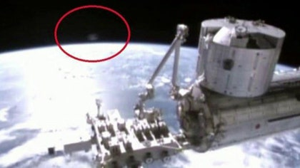 Bloggers claim to have spotted small object on live camera feed. Skeptics dismissing it as an illusion caused by light