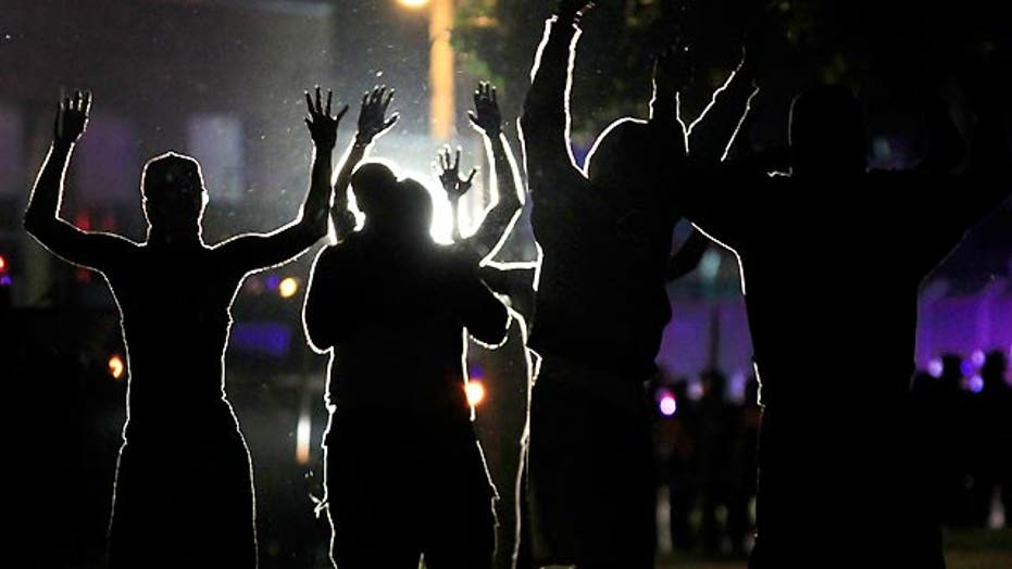 Ferguson 'hands up, don't shoot!' rallying cry questioned