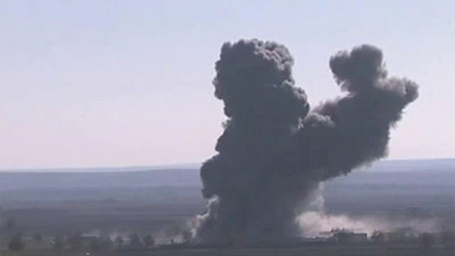 Syrian activists: Coalition strikes target ISIS stronghold