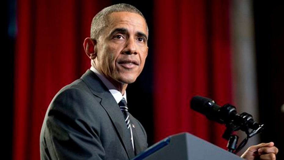 Obama meets with Cabinet, black leaders, police on Ferguson