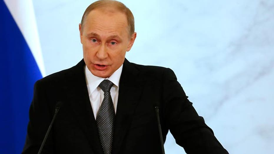Putin defiant against West in address