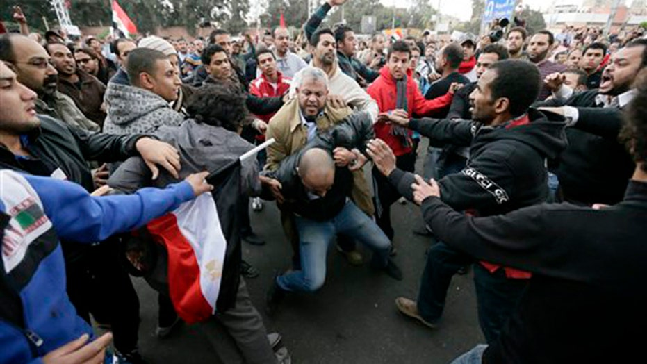 Morsi tells violent protesters to give new talks a chance