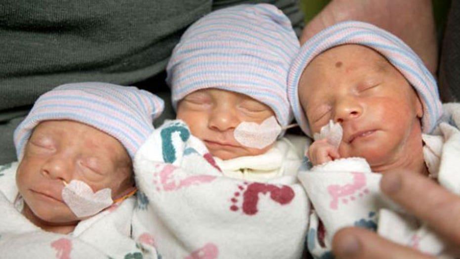 Rare identical triplets born