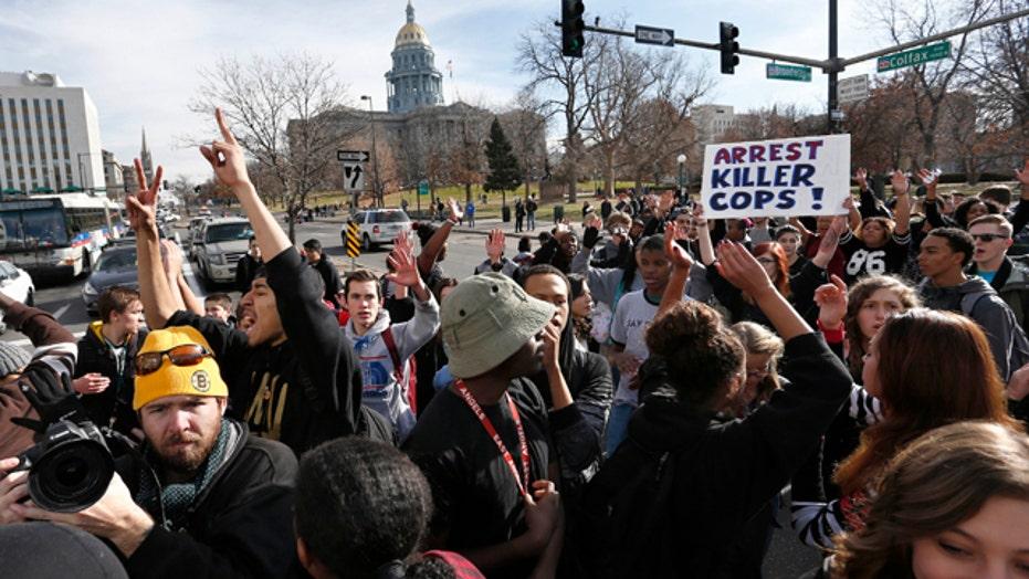 Four Denver officers hit by car during Ferguson protest